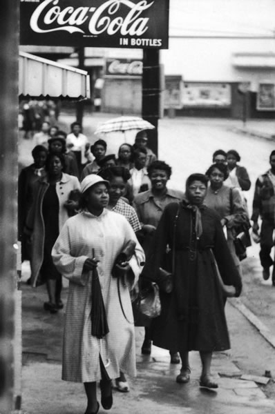 """African-American women were the backbone of the Montgomery bus boycott. Here black women walk to work in February 1956"" (McGuire 109)."